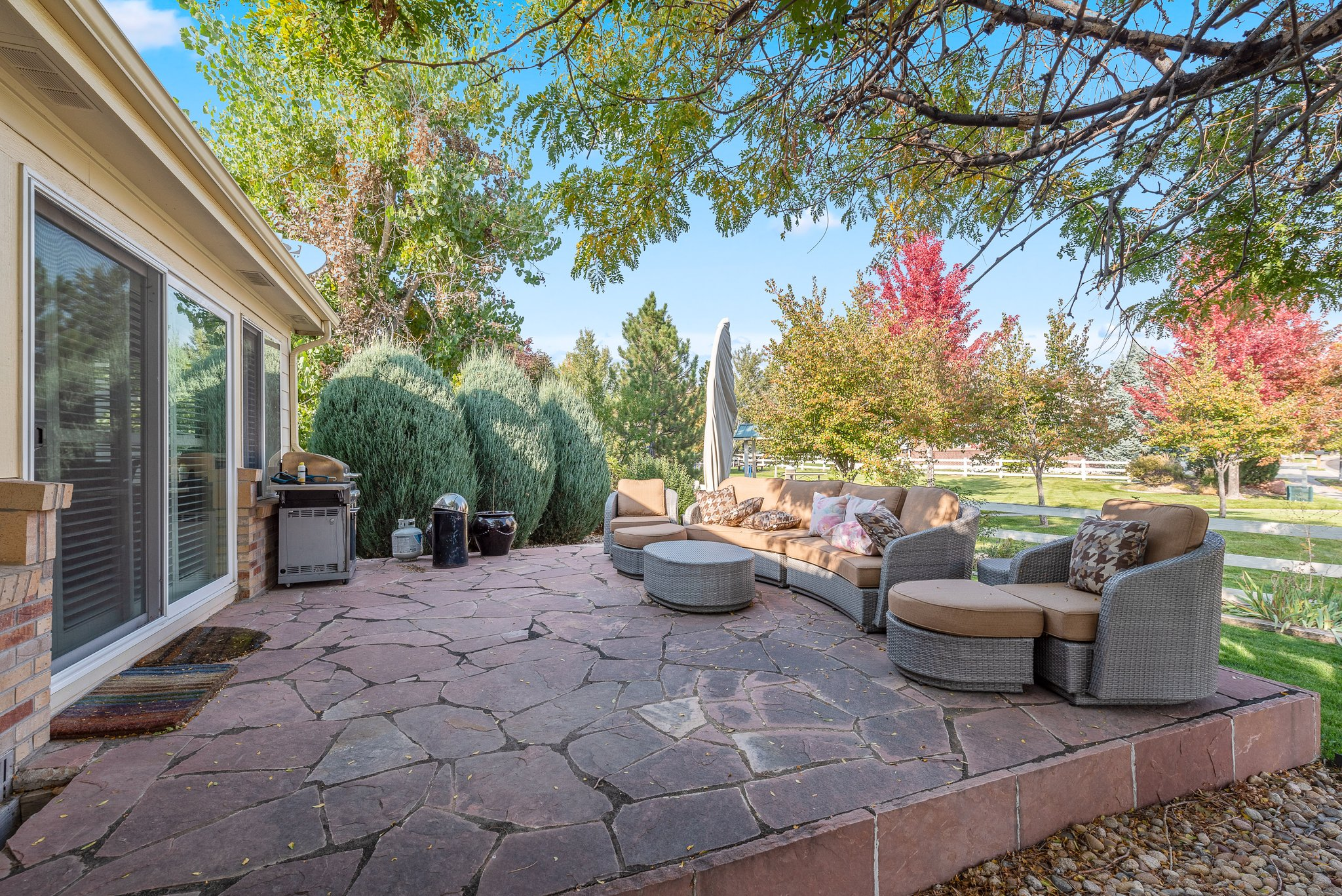 Flagstone patio with mature trees