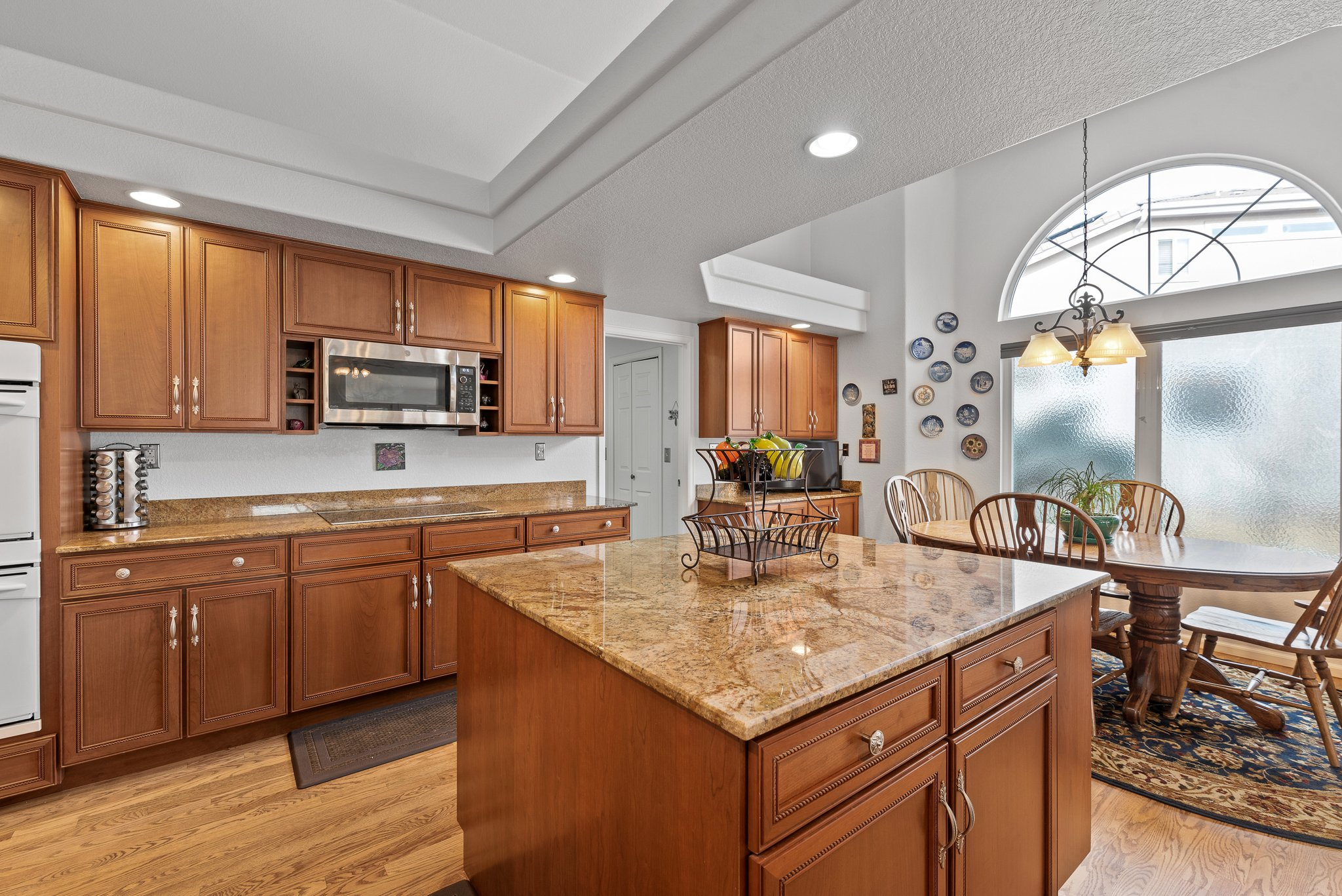 Spacious Kitchen with cherry cabinets and granite counters