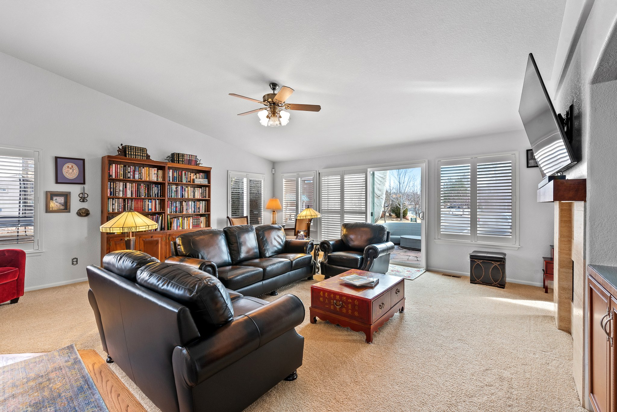 Light and bright family room with plantation shutters