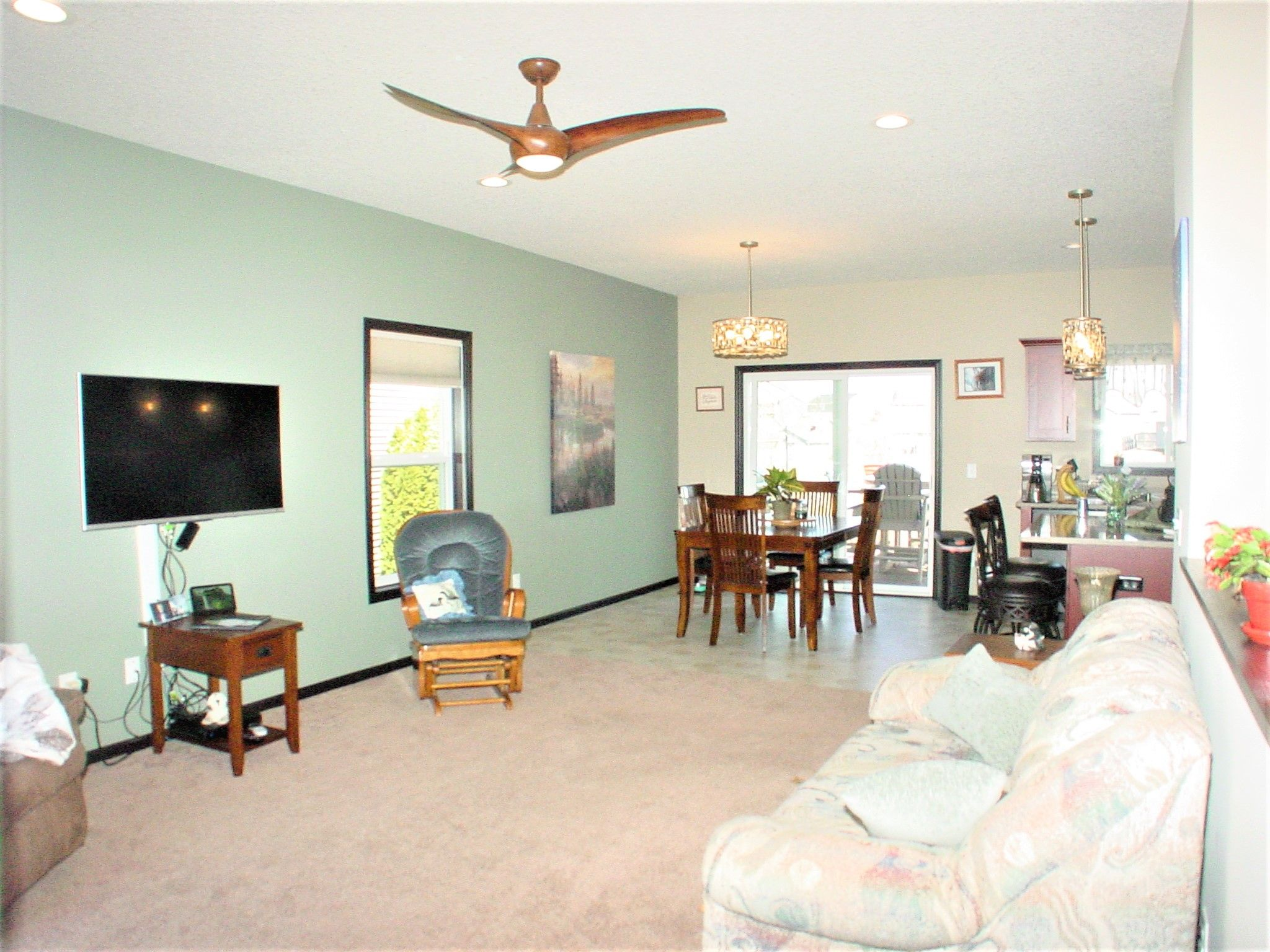 Open concept Great Room, Dining area with attractive recessed lighting and fan