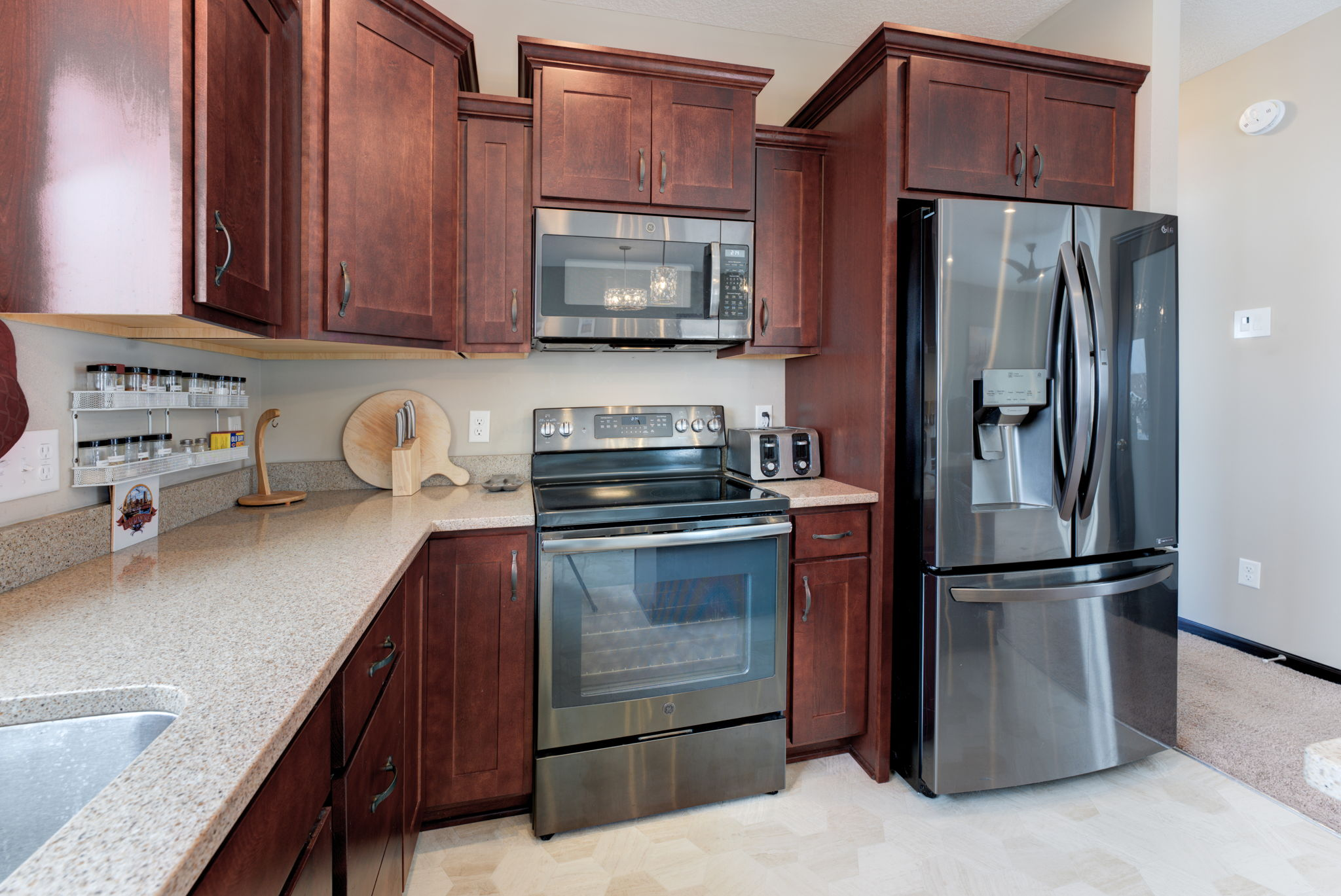 Rich custom cabinetry black stainless steel appliances