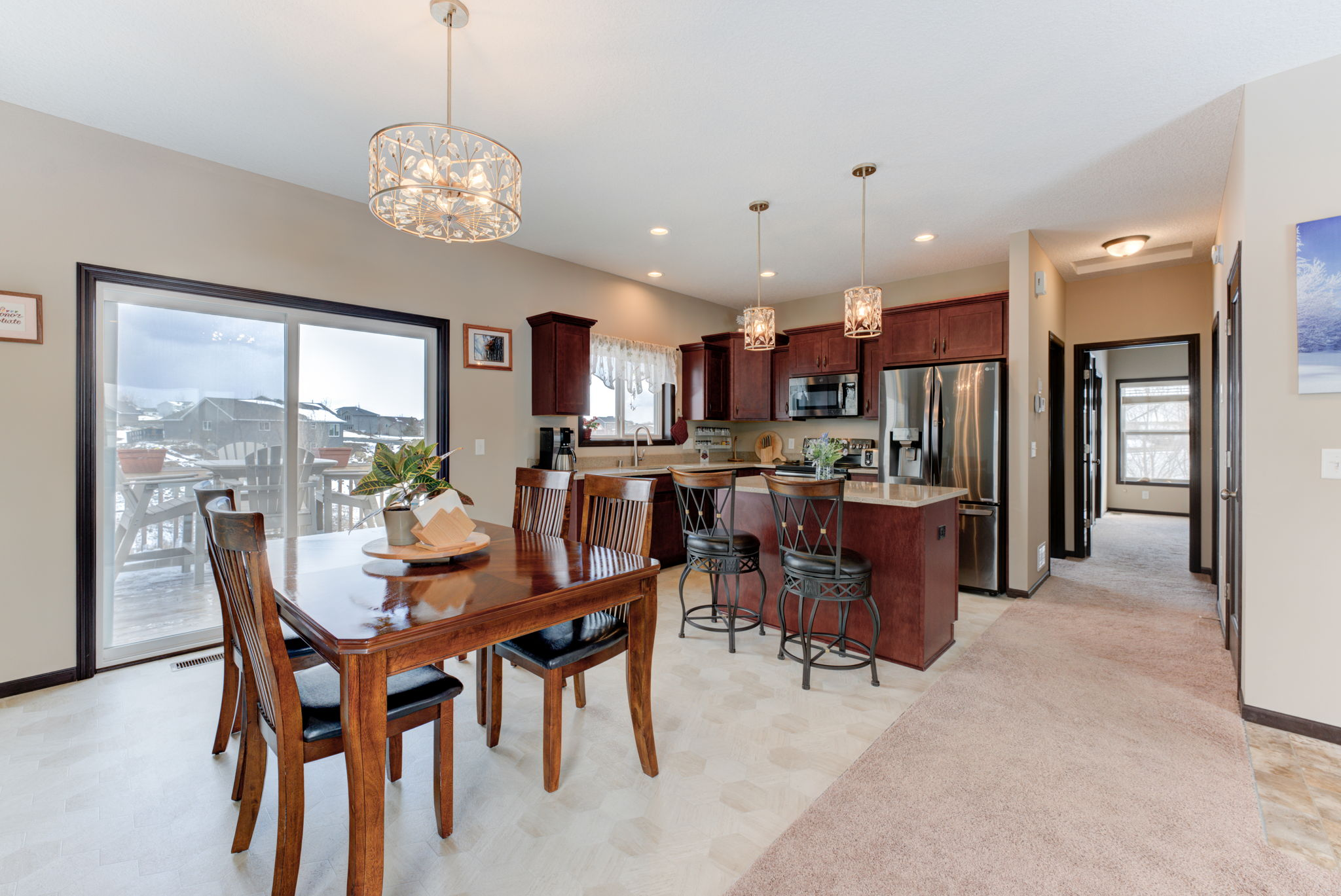 Dining room,Kitchen, sliding doors open to deck with tranquil easterly views
