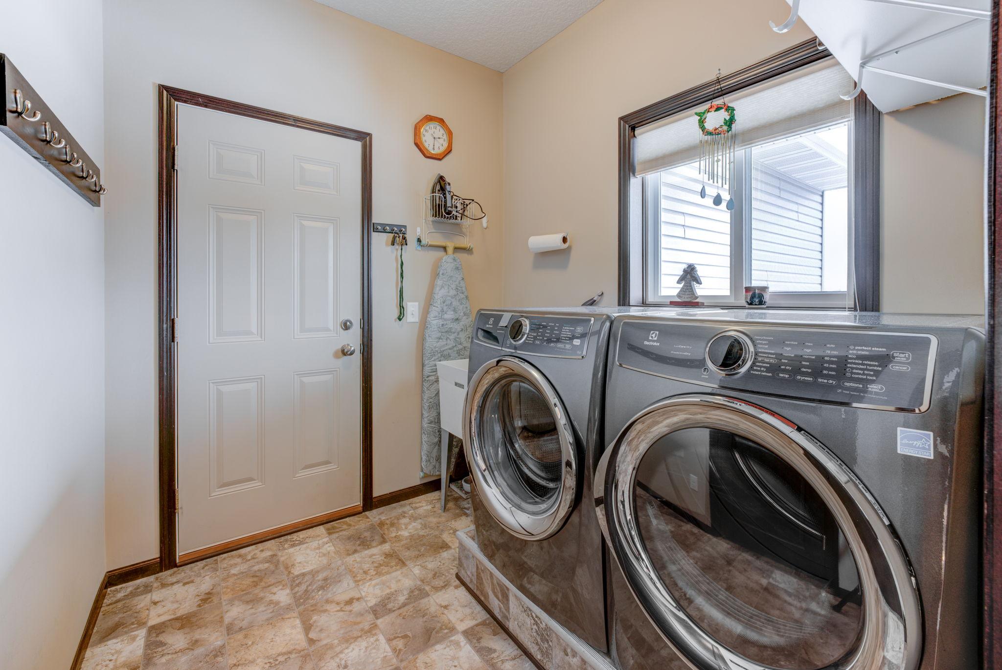 Main level laundry room, laundry tub, pocket door